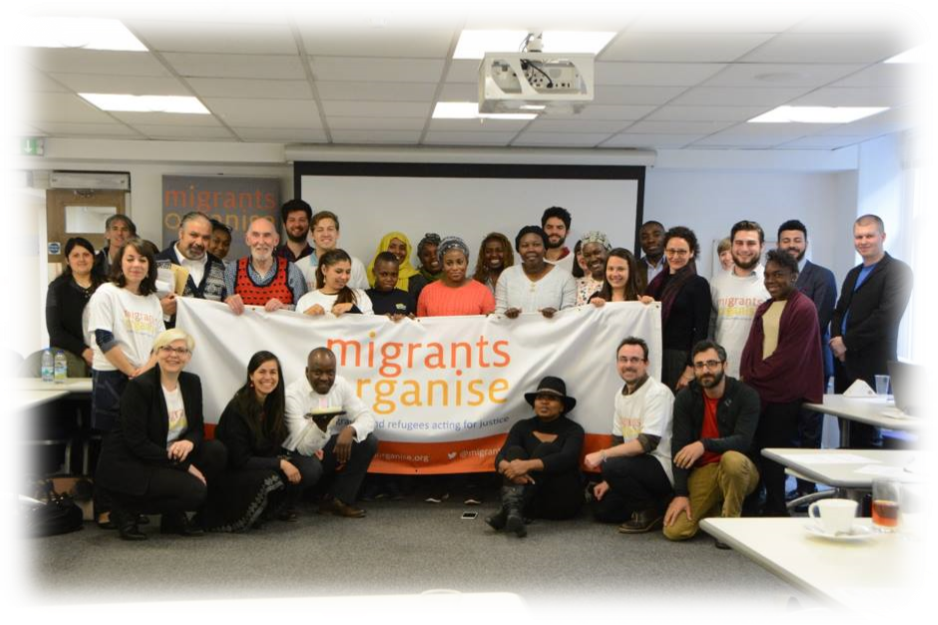 Migrant Action group holding migrants organise sign